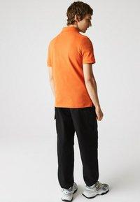 Lacoste - Polo shirt - orange - 2