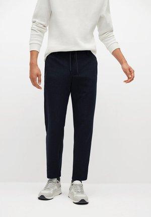 NOLEN - Trousers - dunkles marineblau