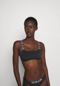 Calvin Klein Swimwear - INTENSE POWER BANDEAU - Bikinitop - black - 0