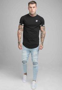 SIKSILK - RIOT BIKER - Jeans Skinny Fit - light wash - 1