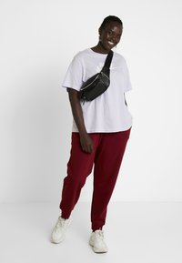 Nike Sportswear - PANT - Tracksuit bottoms - team red/white - 1
