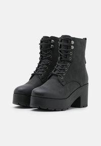 mtng - EMELINE - Šněrovací kotníkové boty - black - 2