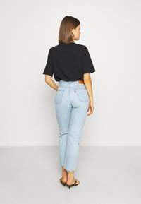 Levi's® - 501® CROP - Džíny Slim Fit - light blue denim - 2
