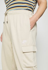 Nike Sportswear - Tracksuit bottoms - rattan/white - 3