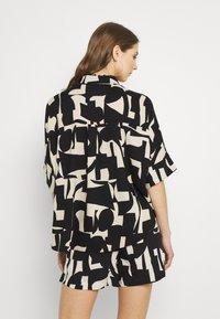 Monki - Button-down blouse - cutouts - 2