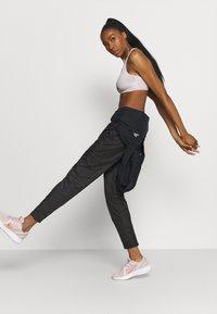 Nike Performance - RUN PANT - Pantalones deportivos - black/gold - 3