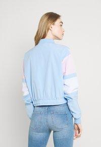 Ellesse - STEPHANIE CROP TRACK  - Summer jacket - light blue - 2