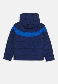 Nike Sportswear - FILLED UNISEX - Winter jacket - blue void - 1