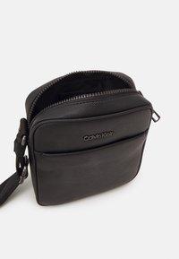 Calvin Klein - REPORTER UNISEX - Across body bag - black - 2