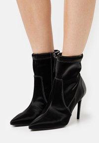 Diesel - SLANTY D-SLANTY MABZC BOOTS - High heeled ankle boots - black - 0