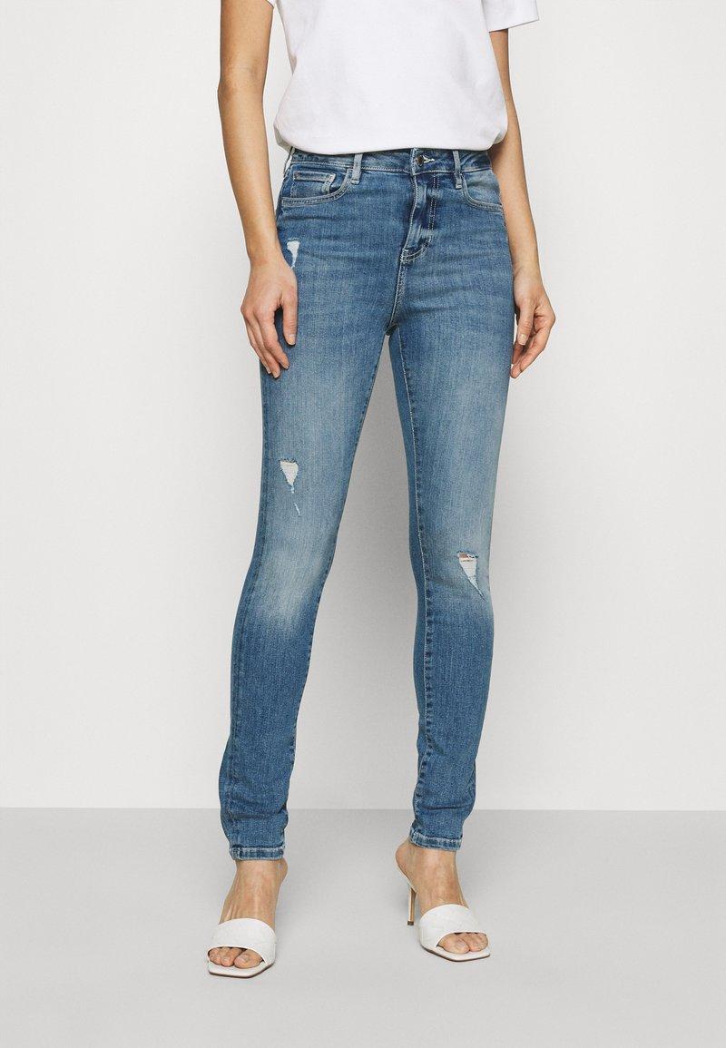 Guess - ULTIMATE SKINNY - Jeans Skinny Fit - soul sister