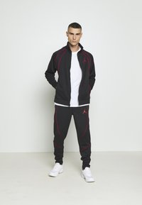 Jordan - JUMPMAN AIR SUIT PANT - Träningsbyxor - black/gym red - 1