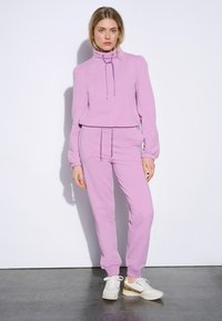 ORSAY - Tracksuit bottoms - lilac - 1
