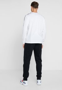 Champion - CUFF PANTS - Verryttelyhousut - black - 2