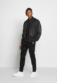 Versace Jeans Couture - PATCH - Polo shirt - black - 1