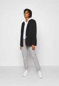 Nike Sportswear - PANT - Tracksuit bottoms - grey heather/white - 1