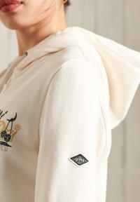 Superdry - Zip-up sweatshirt - cream - 1