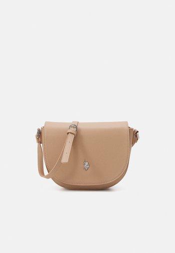 JONES S FLAP BAG - Across body bag - beige