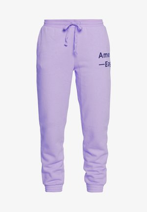 GRAPHIC JOGGER - Tracksuit bottoms - purple
