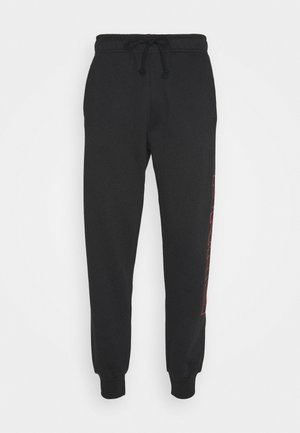 PRAY JOGGER UNISEX - Tracksuit bottoms - black
