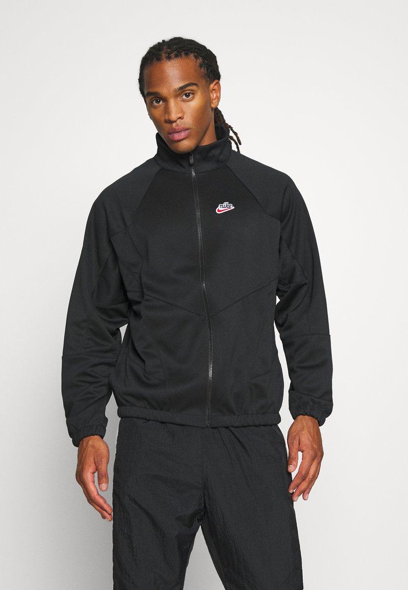 Nike Sportswear - Chaqueta fina - black