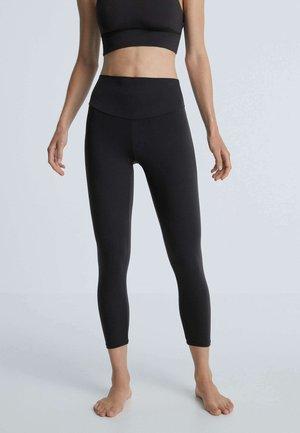 COMFORTLUX - Leggings - Trousers - black