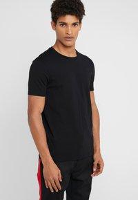 HUGO - ROUND  - Basic T-shirt - black/white - 3
