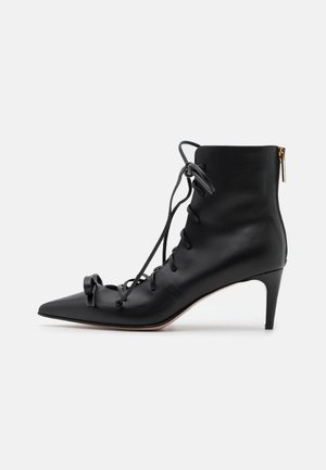 BOOTIE - Lace-up ankle boots - nero