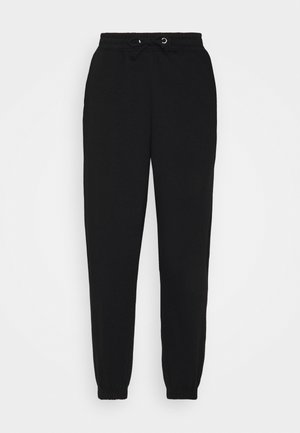 OVERSIZED 90S - Tracksuit bottoms - black