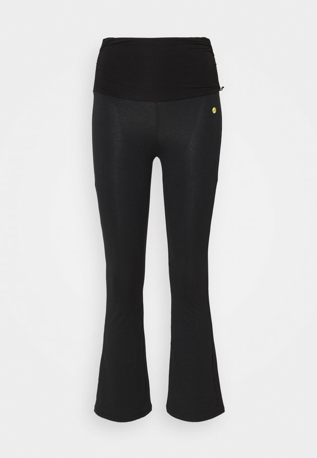 FLARED 7/8 PANTS - Trainingsbroek - black