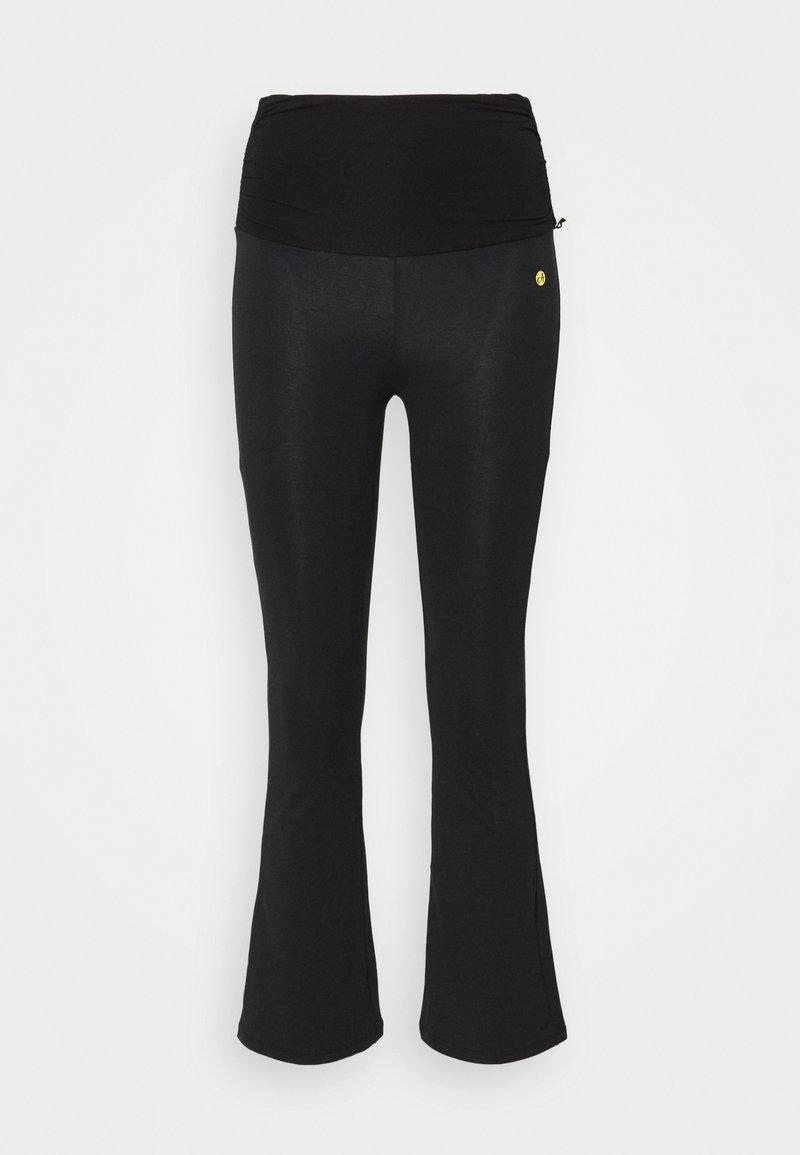 Deha - FLARED 7/8 PANTS - Tracksuit bottoms - black