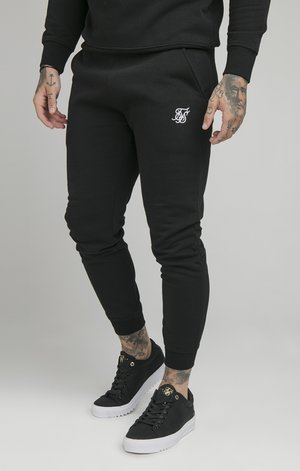 MUSCLE - Jogginghose - black