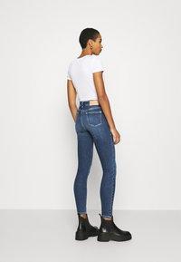 Calvin Klein - HIGH RISE - Jeans Skinny Fit - dark blue - 2