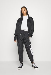 Nike Sportswear - PANT  - Tracksuit bottoms - black/white - 1