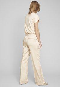 ECHTE - Trousers - pale peach - 2