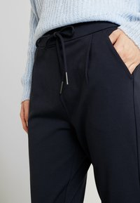 Vero Moda Tall - VMEVA LOOSE STRING PANTS  - Tracksuit bottoms - night sky