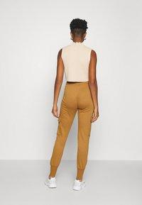 Vero Moda - VMMERCY PANT - Tracksuit bottoms - tobacco brown - 2