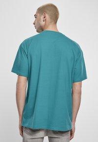 Starter - Print T-shirt - green/yellow/rose - 2