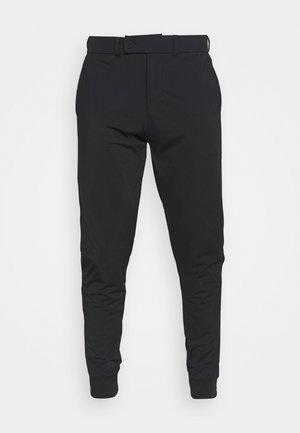 AIRLIGHT TRACKIES - Pantaloni sportivi - true black
