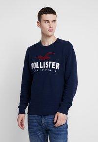 Hollister Co. - TECH LOGO CREW - Mikina - navy - 0