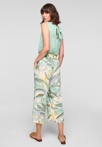 s.Oliver - Trousers - ocean green aop - 2