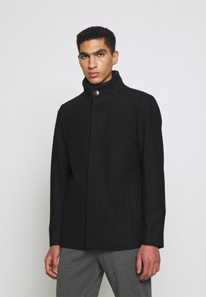 HARVEY - Halflange jas - black