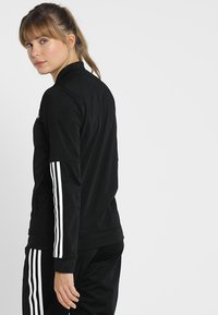 adidas Performance - ESSENTIALS 3STRIPES SPORT TRACKSUIT - Tracksuit - black/white - 2