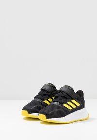 adidas Performance - RUNFALCON I UNISEX - Neutral running shoes - core black/shock yellow/footwear white - 3