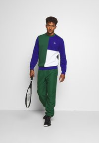 Lacoste Sport - TENNIS PANT - Tracksuit bottoms - green - 1