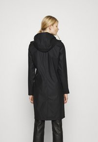 Vero Moda - VMSHADYSOFIA  - Waterproof jacket - black - 2