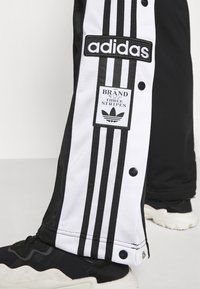 adidas Originals - ADIBREAK - Pantalon de survêtement - black - 6