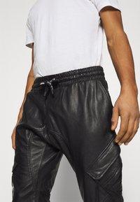 Tigha - TANO - Kožené kalhoty - black - 3