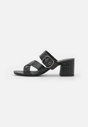VAIANA - Heeled mules - black