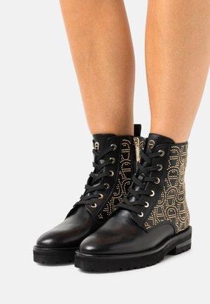 AVA - Bottines à lacets - black